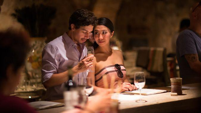 Young romantic couple on vacation in wine tasting.