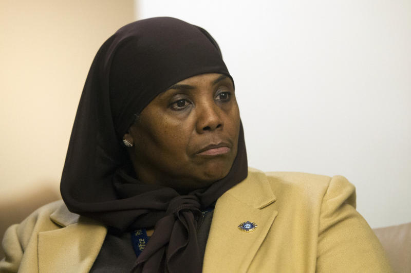 "In this Jan. 9, 2018 photo, Movita Johnson-Harrell, Interim Supervisor of Victim Services, looks on after getting introduced, during a press conference at the District Attorney's Office in Philadelphia. Johnson-Harrell, the first female Muslim member of the Pennsylvania House of Representatives, said Tuesday, March 26, 2019, she was offended by a colleague's decision to open a voting session with a prayer a day earlier that ""at the name of Jesus every knee will bow."" (Jose F/Moreno/The Philadelphia Inquirer via AP)"