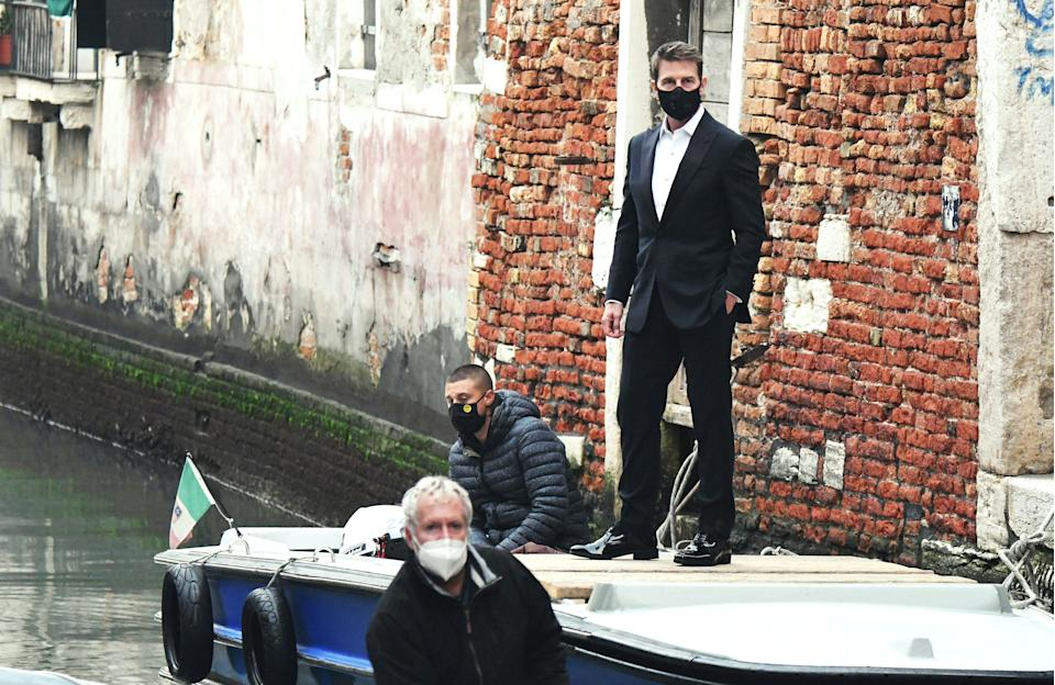 <p>Tom Cruise stands on a boat during the shooting of 'Mission Impossible 7' in Venice in October 2020.</p> (Photo by Andrea Pattaro/AFP via Getty Images)