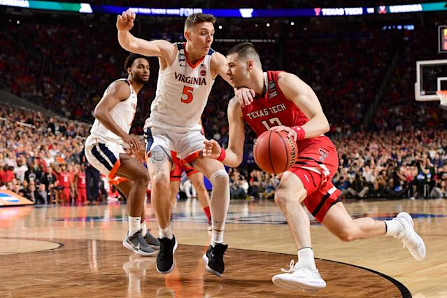 MINNEAPOLIS, MINNESOTA - APRIL 08: Matt Mooney #13 of the Texas Tech Red Raiders drives against Kyle Guy #5 of the Virginia Cavaliers during the first half in the 2019 NCAA men's Final Four National Championship game at U.S. Bank Stadium on April 08, 2019 in Minneapolis, Minnesota. (Photo by Jamie Schwaberow/NCAA Photos via Getty Images)