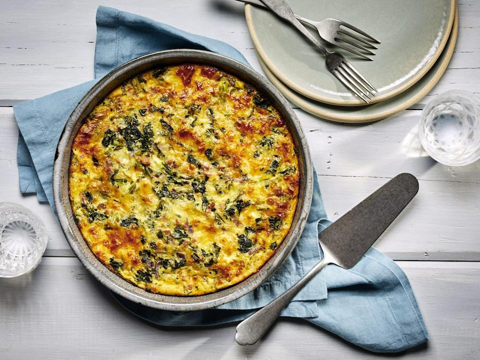 "<p><strong>Recipe: </strong><a href=""https://www.southernliving.com/recipes/crustless-spinach-quiche"" rel=""nofollow noopener"" target=""_blank"" data-ylk=""slk:Crustless Ham and Spinach Quiche"" class=""link rapid-noclick-resp""><strong>Crustless Ham and Spinach Quiche</strong></a></p> <p>We're always up for a new quiche recipe that we can enjoy at breakfast, lunch, or dinner. This one doesn't require fussy homemade dough and calls for a simple ingredient list that can be adjusted with what you have on hand. ""It's so easy and delicious!"" said one reader.</p>"