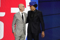 NBA Commissioner Adam Silver greets Cade Cunningham who was picked as the number one overall pick by the Detroit Pistons during the NBA basketball draft, Thursday, July 29, 2021, in New York. (AP Photo/Corey Sipkin)