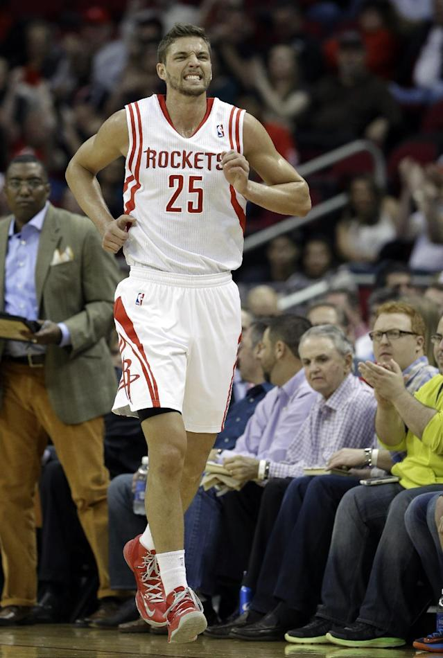 Houston Rockets' Dwight Howard grimaces after being fouled in the first half of an NBA basketball game against the Denver Nuggets, Saturday, Nov. 16, 2013, in Houston. (AP Photo/Pat Sullivan)