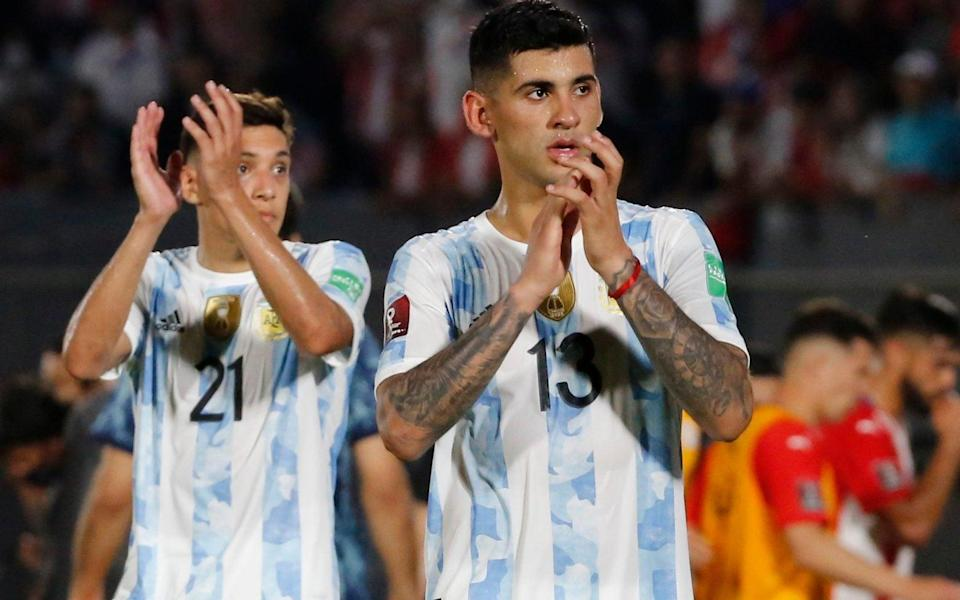 Cristian Romero of Argentina greets the fans after a match between Paraguay and Argentina - Getty Images