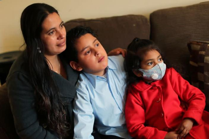 Emiliana, 32, poses for a photo with her son, Leonardo, 10, and daughter, Emily, 5, at their apartment in Los Angeles