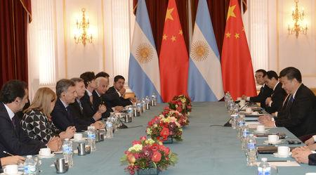 FILE PHOTO: Argentina's President Mauricio Macri (3rd L) and his Chinese counterpart Xi Jinping (R) take part in a meeting during the Nuclear Security Summit in Washington April 1, 2016.  Argentine Presidency/Handout via Reuters ATTENTION EDITORS - THIS IMAGE WAS PROVIDED BY A THIRD PARTY. NO RESALES. NO ARCHIVE.