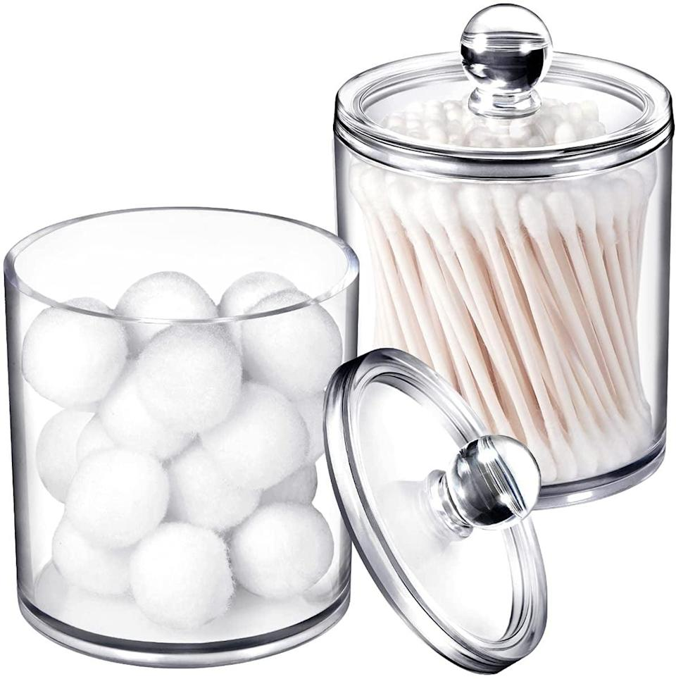 <p>Store your routine essentials like cotton pads, Q-tips, and more in these <span> Apothecary Jars Bathroom With Labels (2 Pack)</span> ($9).</p>
