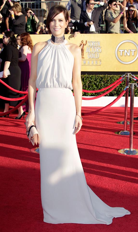 Kristen Wiig (in Balenciaga) arrives at the 18th Annual Screen Actors Guild Awards at The Shrine Auditorium in Los Angeles, California.