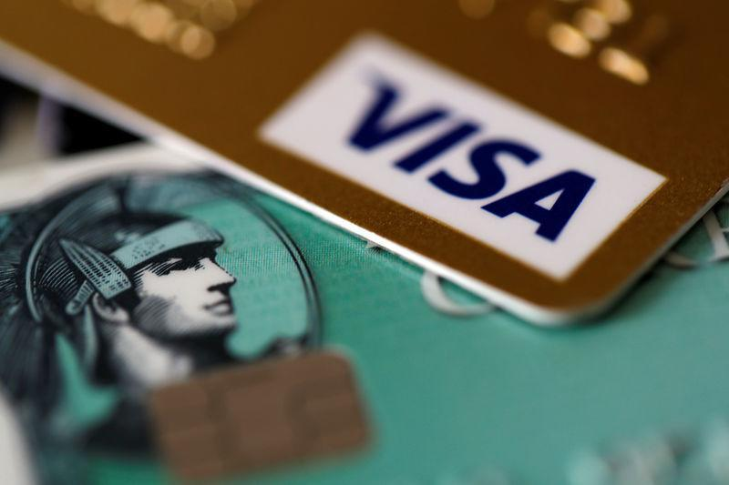 An American Express and a Visa credit cards are seen on a computer keyboard in this picture illustration taken September 6, 2017. REUTERS/Philippe Wojazer/Illustration/Files