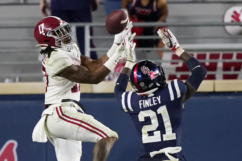 Alabama wide receiver Jaylen Waddle (17) pulls in a pass over Mississippi defensive back A.J. Finley (21) during Alabama's win on Oct. 10. (AP)