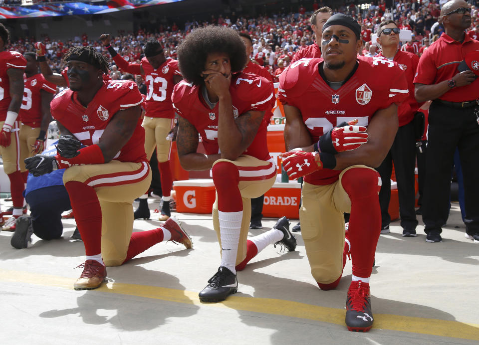 Eli Harold, Colin Kaepernick and Eric Reid kneel during the national anthem before their NFL game against the Dallas Cowboys on Sunday, Oct. 2, 2016. (Getty)