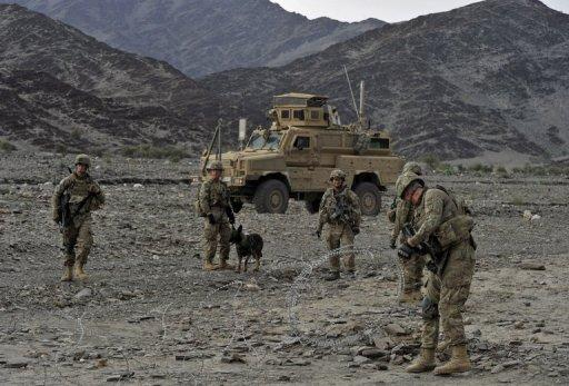 File photo shows US soldiers setting up concertina wire during a mission in the Turkham Nangarhar region of Afghanistan bordering Pakistan. Washington and Kabul have hailed breakthroughs towards signing a treaty on relations after 2014 -- but it will not cover the crucial issue of the status of any US troops remaining in Afghanistan