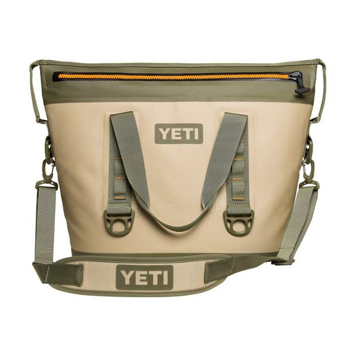 """<p><strong>YETI</strong></p><p>rei.com</p><p><strong>$224.99</strong></p><p><a href=""""https://www.rei.com/product/117210"""" target=""""_blank"""">Shop Now</a></p><p>Yeti makes top-of-the-line <a href=""""https://www.popularmechanics.com/adventure/outdoor-gear/g3116/best-soft-cooler/"""" target=""""_blank"""">soft coolers</a>, and the Hopper Two is no exception. We can confirm that it succeeds in carrying up to 30-pounds of ice without leaking once on a camping trip. The detachable shoulder strap also makes it easy to carry, even when it's loaded up with your water and chilled snacks.</p>"""