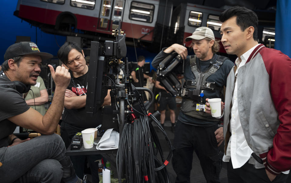 Director Destin Daniel Cretton, fight instructor Alan Tang, crew camera operator, and Simu Liu on the set of Marvel Studios' Shang-Chi and the Legend of the Ten Rings. (Photo by Jasin Boland/Marvel Studios)