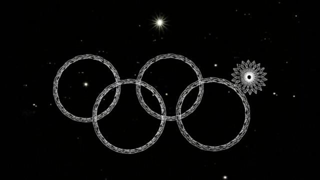 "The 2014 Russian Winter Olympic Games kick off with an opening ceremony one fan calls, ""one of the greatest,"" even though one of the Olympic rings didn't light up. Gavino Garay reports."