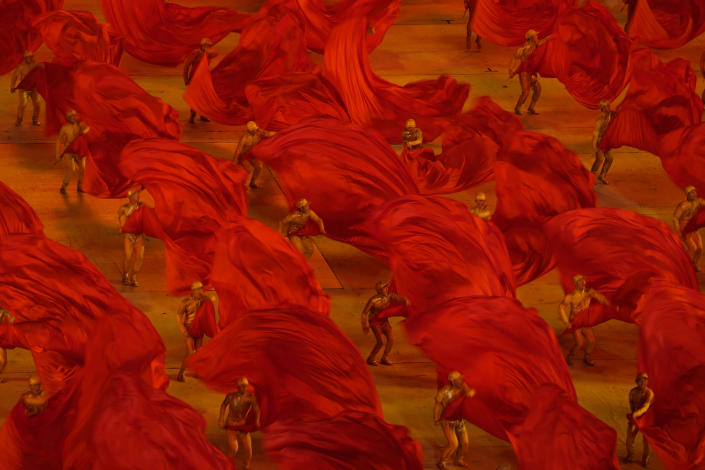 Performers take part in a gala show ahead of the 100th anniversary of the founding of the Chinese Communist Party in Beijing on Monday, June 28, 2021. China is marking the centenary of its ruling Communist Party this week by heralding what it says is its growing influence abroad, along with success in battling corruption at home. (AP Photo/Ng Han Guan)