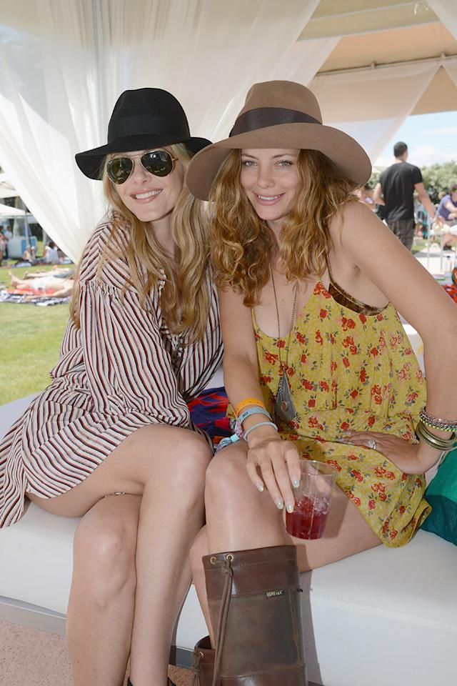 Monet Mazur and Bijou Phillips attend the Lacoste pool party during the Coachella Music Festival in Thermal, California.