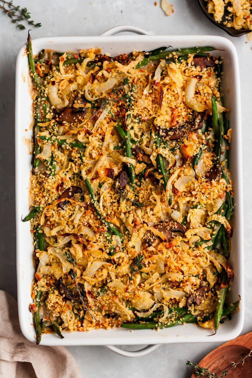 """<p>This homemade <a href=""""https://www.countryliving.com/food-drinks/g2728/green-bean-casserole-recipe/"""" rel=""""nofollow noopener"""" target=""""_blank"""" data-ylk=""""slk:green bean casserole"""" class=""""link rapid-noclick-resp"""">green bean casserole</a> is so incredible, you won't even realize it's lightened up. This blogger calls it """"creamy, crunchy, and fresh.""""</p><p><strong>Get the recipe at <a href=""""https://www.ambitiouskitchen.com/best-homemade-healthy-green-bean-casserole/"""" rel=""""nofollow noopener"""" target=""""_blank"""" data-ylk=""""slk:Ambitious Kitchen"""" class=""""link rapid-noclick-resp"""">Ambitious Kitchen</a>.</strong> </p>"""