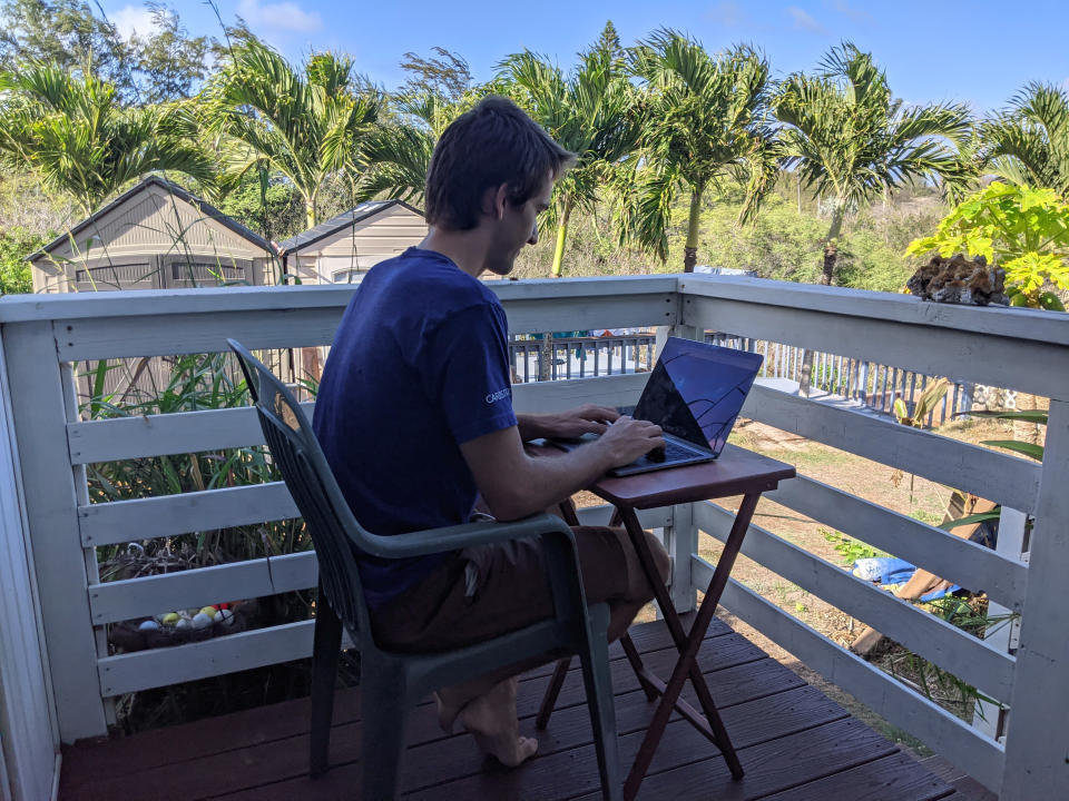 In this photo provided by Marley C. Alford, Raymond Berger, a New York City software engineer, works remotely on Nov. 22, 2020, in Kahului, Hawaii. A group of Hawaii leaders is trying to attract people like Berger to work remotely from Hawaii during the pandemic. (Marley C. Alford via AP)