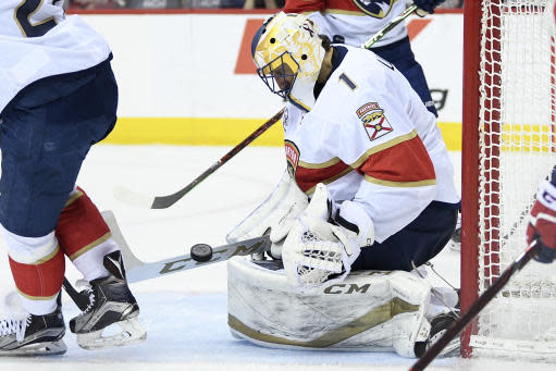 Florida Panthers goaltender Roberto Luongo (1) stops the puck during the third period of an NHL hockey game against the Washington Capitals, Saturday, Feb. 9, 2019, in Washington. (AP Photo/Nick Wass)