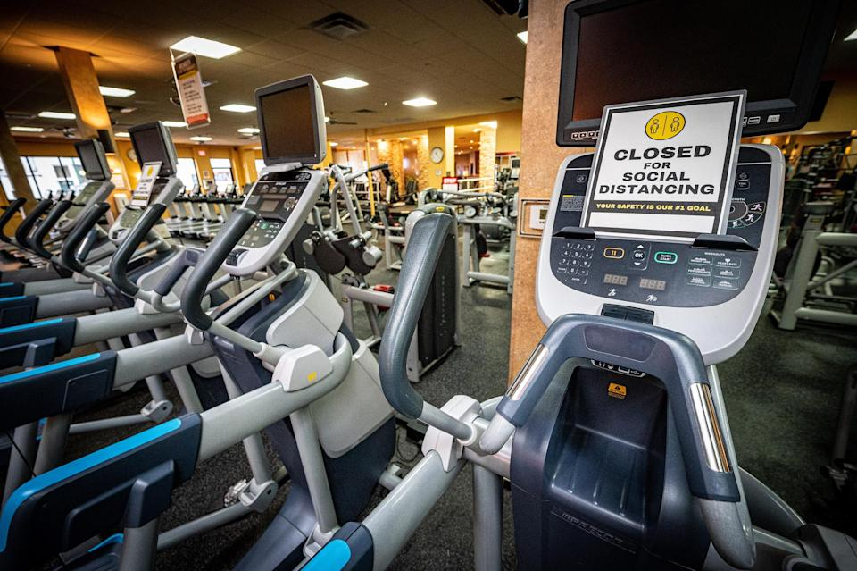 Social distancing signs on machines at Gold's Gym in East Northport, New York, on Aug. 19, 2020, ahead of reopening after the coronavirus shutdown. (Photo: J. Conrad Williams Jr./Newsday via Getty Images)