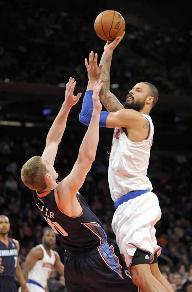 New York Knicks' Tyson Chandler, right, pits up a shot over Charlotte Bobcats' Cody Zeller during the first quarter of an NBA basketball game, Friday, Jan. 24, 2014, at Madison Square Garden in New York. The Knicks won 125-96. (AP Photo/Bill Kostroun)