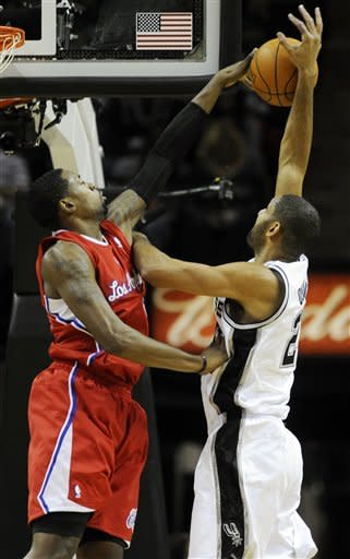 Los Angeles Clippers center DeAndre Jordan blocks a shot attempt by San Antonio Spurs forward Tim Duncan during the first half of an NBA basketball game in San Antonio, Wednesday, Dece. 28, 2011. (AP Photo/Bahram Mark Sobhani)