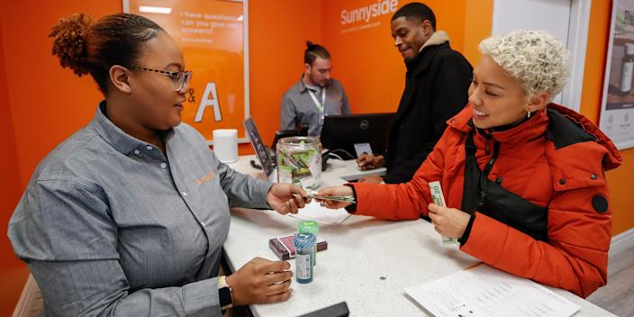 A woman makes a purchase in Chicago, Illinois, on the first day of legalization throughout the state.