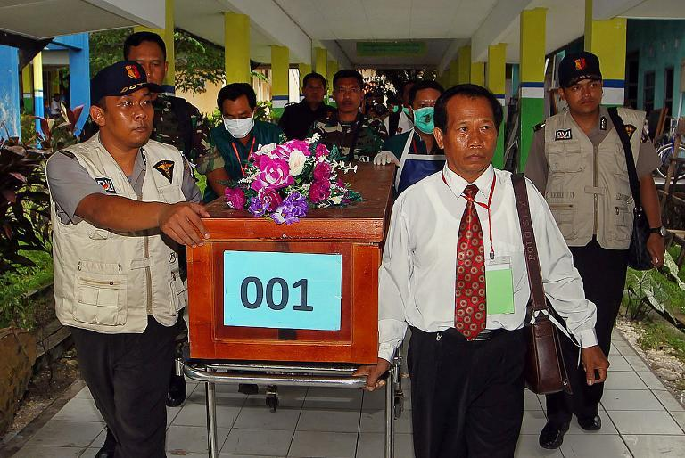 A coffin of a victim of AirAsia flight QZ8501 is transferred from a local hospital in Pangkalan Bun -- the town with the nearest airstrip to the crash site in Central Kalimantan -- on December 31, 2014