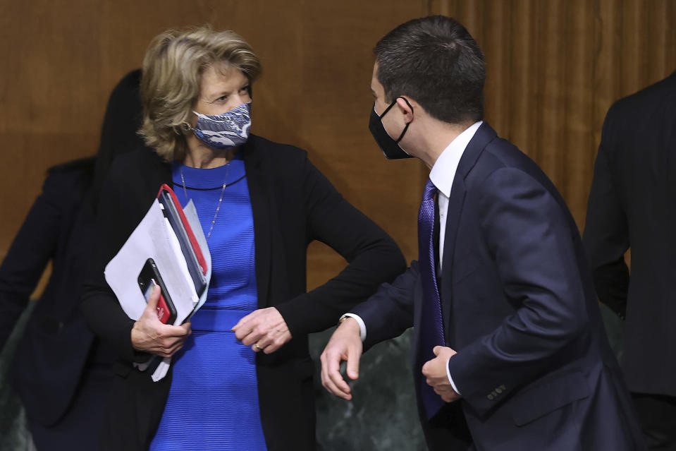 Sen. Lisa Murkowski, R-Alaska, greets Transportation Secretary Pete Buttigieg before a Senate Appropriations Committee hearing on Capitol Hill, Tuesday, April 20, 2021 in Washington. (Chip Somodevilla/Pool via AP)