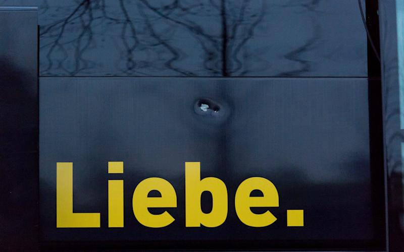 Damage to the Borussia Dortmund team bus - Credit: EPA/STR