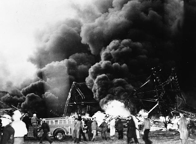 <p>Firefighters on scene of the Hindenburg explosion in New Jersey on May 6, 1937. (ullstein bild/ullstein bild via Getty Images) </p>