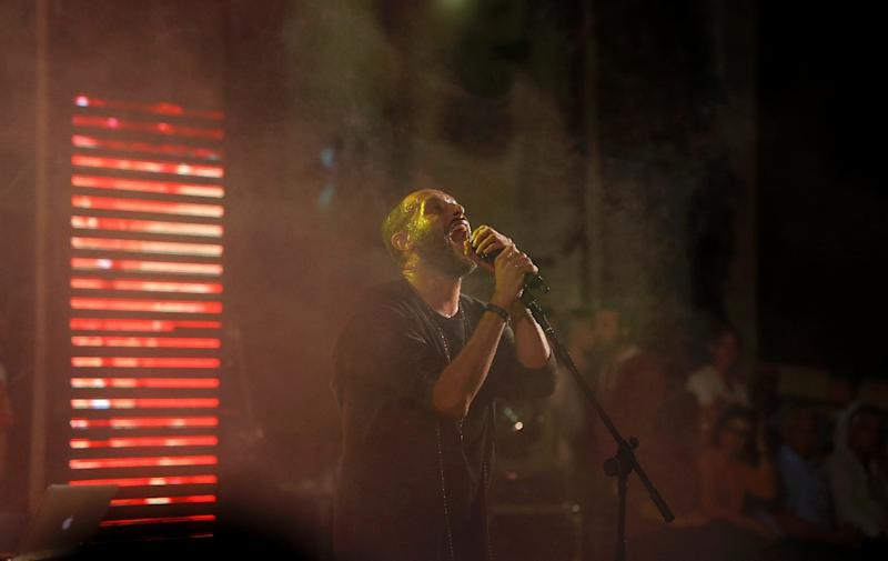 Rapper Tamer Nafar has been accused of incitement by Israel's Culture Minister (AFP Photo/Ahmad Gharabli)