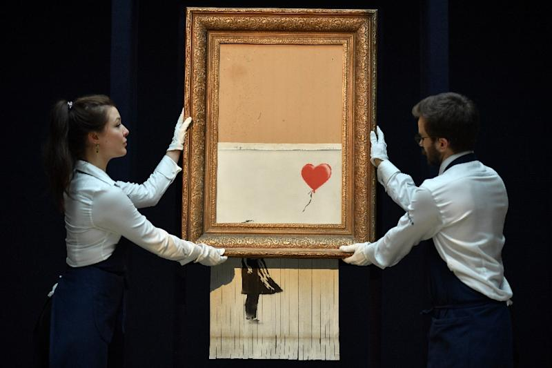 "Banksy put ""Girl with Balloon"" through a hidden shredder after it was auctioned (AFP Photo/Ben STANSALL)"