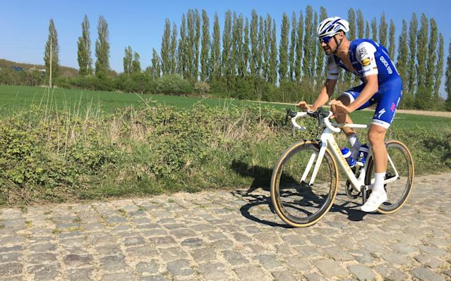 <span>Tom Boonen rides around three bike lengths behind Van Avermaet on the 1.4-kilometre cobbled section from Beuvry-la-Forêt to Orchies</span> <span>Credit: JOHN MACLEARY </span>