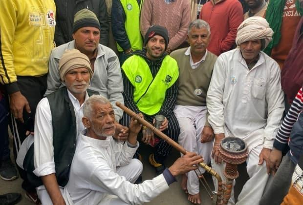 Jaswinder Singh Bains of Surrey, B.C. — centre, in the green vest — also known as rapper Jazzy B says he was blocked from Twitter in India because of his outspoken support of farmers protesting controversial new agricultural laws in India. (Submitted by Jaswinder Singh Bains - image credit)