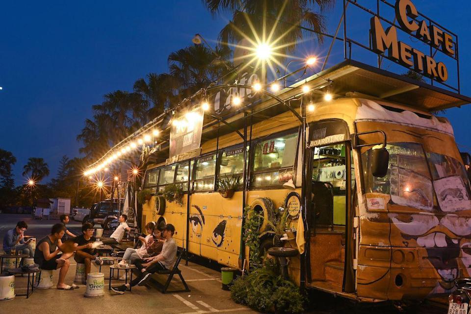 "<p>This Hanoi, Vietnam, cafe may have wheels, but it's not going anywhere. The Hanoi Bus Cafe offers cafe drinks and bites both inside and outside a parked and painted bus. The coffee shop also encourages guests to practice <a href=""https://www.theactivetimes.com/how-to-be-sustainable?referrer=yahoo&category=beauty_food&include_utm=1&utm_medium=referral&utm_source=yahoo&utm_campaign=feed"" rel=""nofollow noopener"" target=""_blank"" data-ylk=""slk:sustainability"" class=""link rapid-noclick-resp"">sustainability</a> by recycling onsite.</p>"