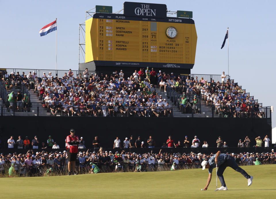 United States' Collin Morikawa places his ball on the 18th green during the final round of the British Open Golf Championship at Royal St George's golf course Sandwich, England, Sunday, July 18, 2021. (AP Photo/Ian Walton)