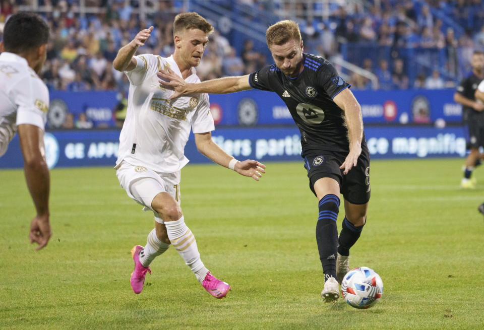 CF Montreal midfielder Djordje Mihailovic fends off Atlanta United's Amar Sejdic during the first half of an MLS soccer match Wednesday, Aug. 4, 2021, in Montreal. (Paul Chiasson/The Canadian Press via AP)P)