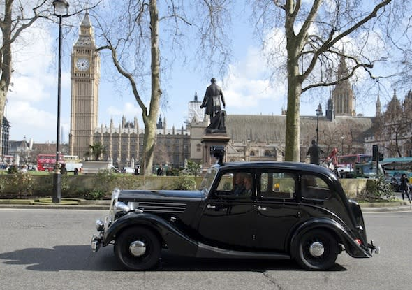 Feb 26, 2014 - London, UK - A convoy of historic police cars from the past six decades took to the streets of London for the last time today before being moved to a new home.The iconic vehicles included a 1948 Wolseley used to patrol the Queen's coronation and an armoured vehicle fitted with bullet-proof glass.Along with a number of classic police bikes, they were driven from a Metropolitan Police garage near Hampton Court to Scotland Yard's driving school in Hendon. (Credit Image: © Jamie Wiseman/Daily Mail/SOLO Syndication)