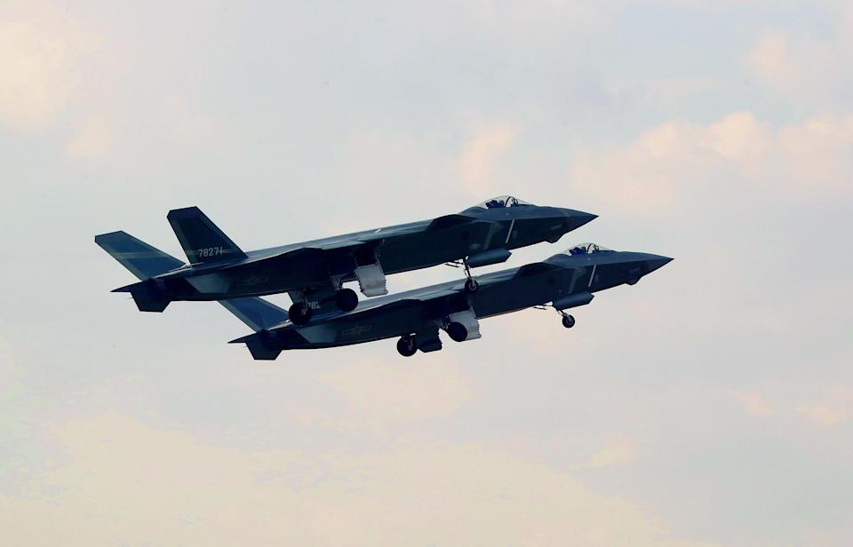 File photo shows J-20 stealth fighters in a training. Air Force of the People's Liberation Army of China has carried out real combat training, with the involvement of the J-20 stealth fighter and the Y-20 military transport aircraft, according to a military statement. (Xinhua/Li Shaopeng via Getty Images)
