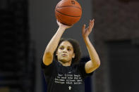 Southern California guard Endyia Rogers wears a shirt with a statement about social injustices as she warms up before an NCAA college basketball game against Stanford in Santa Cruz, Calif., Sunday, Jan. 24, 2021. Student-athletes across college campuses are taking a lead from professional athletes by using their platforms in hopes of creating change. (AP Photo/Jeff Chiu)