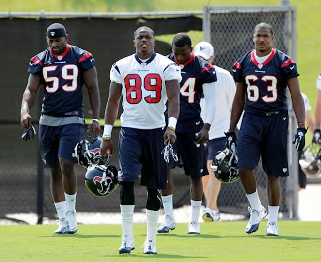 HOUSTON - MAY 21: Linebacker Whitney Mercilus #59, Jerrell Jackson #89 and D.J. Bryant #63 of the Houston Texans arrive for the first day of OTA's at the Methodist Training Center at Reliant Park on May 21, 2012 in Houston, Texas. (Photo by Bob Levey/Getty Images)