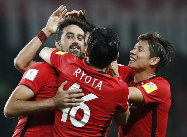 Japan's Urawa Reds Mauricio Antonio, left, celebrates scoring his side's third goal during the Club World Cup soccer match for the fifth place between Wydad Athletic Club and Urawa Reds at the Hazza Bin Zayed stadium in Al Ain, United Arab Emirates, Tuesday, Dec. 12, 2017. (AP Photo/Hassan Ammar)