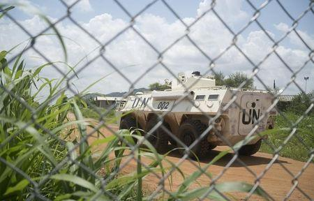 A United Nations peacekeepers ride in their armored personnel carrier (APC) as they patrol the perimeter of the protection of civilians site hosting about 30,000 people displaced during the recent fighting in Juba, South Sudan, July 22, 2016. REUTERS/Adriane Ohanesian