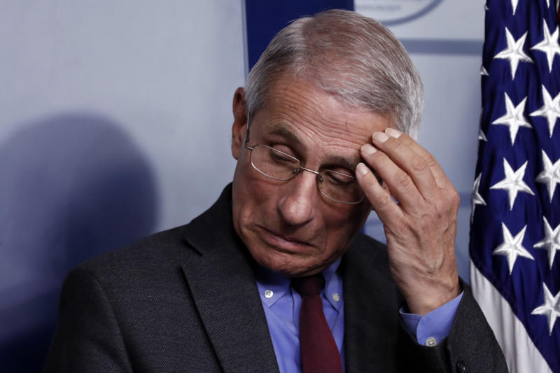 Dr. Anthony Fauci, director of the National Institute of Allergy and Infectious Diseases, listens during a briefing on coronavirus in the Brady press briefing room at the White House, Saturday, March 14, 2020, in Washington. (AP Photo/Alex Brandon)