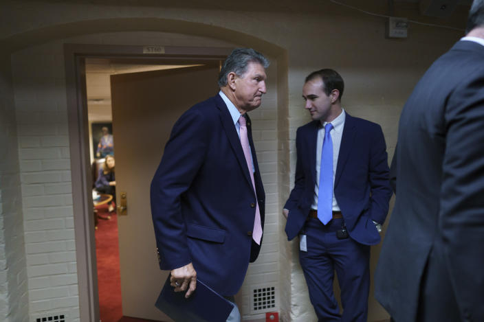 Sen. Joe Manchin, D-W.Va., a key infrastructure negotiator, emerges after working behind closed doors with other Democrats in a basement room at the Capitol in Washington, Wednesday, June 16, 2021. (AP Photo/J. Scott Applewhite)