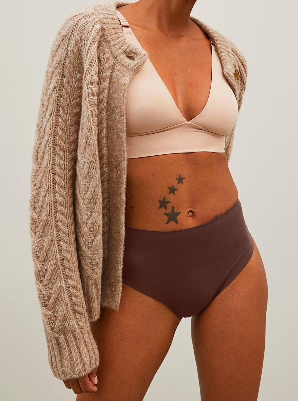 """Everlane's always turning basic-but-better options, like this high-cut brief that'll give you legs for days. $18, Everlane. <a href=""""https://www.everlane.com/products/womens-renew-invisible-thong-darktan?"""" rel=""""nofollow noopener"""" target=""""_blank"""" data-ylk=""""slk:Get it now!"""" class=""""link rapid-noclick-resp"""">Get it now!</a>"""