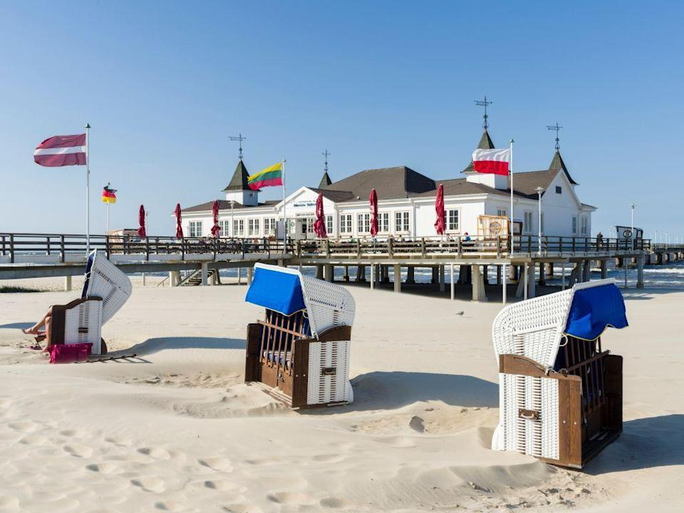 <p>Don't think of Germany when you think of beach vacations? Think again. Located just off Germany's northern coast in the Baltic Sea, Usedom Island is home to miles of white sand beach covered in classic wicker beach chairs that Berliners flock to in the summer.</p>