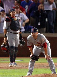 St. Louis pitcher Marc Rzepczynski and catcher Yadier Molina react to the two-run double hit by Rangers catcher Mike Napoli in Game 5 of the World Series